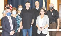 The Crawford County Drug Court program held a graduation ceremony Friday morning. Jesse Cochran, center, graduated the two-year program. He is pictured with drug court officials who supported him and other particpants in the program. Angela Downing | Daily News