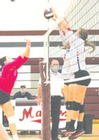 Lawrenceville's Serena Buchanan and Abbie Vaughn (right) team up to block a tip attempt in a match against Robinson Oct. 5. The Lady Indians held a late lead in the Little Illini Conference and even had match point, but could not hang on in a three-set loss (21-25, 25-21, 24-26). The Lady Indians rebounded with a two-set win over Martinsville Oct. 7 (25-23, 25-15) and have now won nine of their last 11 matches. Josh Brown | Daily Record