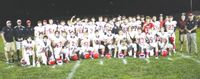 Lawrenceville High School's football team celebrates after claiming the Crawford County Shrine Game trophy following their 12-9 win at Robinson Friday night. The Indians will have the opportunity to win another trophy this Friday, as they will play host to Lawrence County rival Red Hill in the annual Oil Field Trophy Game at Ed Loeb Field. Josh Brown | Daily Record