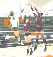Lincoln Trail's Hallee Gauna (left) battles at the net with a pair of Shawnee players during Tuesday night's match in the LTC Sports Center gym. Gauna recorded 12 kills and six blocks for the Lady Statesmen, as they won the match in three sets (25-23, 25-14, 25-16) to snap a 10-match losing streak. Josh Brown | Daily News