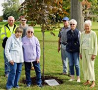 Before totally calling it quits, the Lawrenceville Garden Club planted a tree at Lawrenceville City Park commemorating 67 years of city beautification. Four members of the club, plus Fry's Landscaping, planted the tree which is a Crimson King Maple.  Club members who participated in the tree planting include: (front row, from left), Ann Umfleet, Ellen Brown, Jean Leo and Frances Brinkley. Back row, from left, are: Dave Helderman, from the Lawrenceville Parks Department, along with Ray Hull and Bob Fry, of Fry's Landscaping.