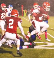 Lawrenceville's Ryan Schultz leaves his feet in an attempt to avoid a tackle and gain extra yards during the annual Oil Field Trophy Game Friday night. Also seen in the picture for the Indians are Leyton Ivers (2), Tanner Waller (26) and Bryant Jenkins (back) along with Red Hill's Ben Stimler and Ethyn Tarr, while making the tackle for the Salukis is Dylan Camden. Schultz ran for 32 yards, while also catching three passes for 42 yards and a touchdown in the Indians' 28-0 win. Josh Brown | Daily Record