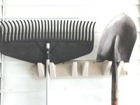 Long-handled tools can be stored conveniently on hanging racks or tool holders, which will help prevent damage to sharpened edges and keeps the tools organized. Contributed photo