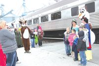 Visitors to the Indiana Railroad's Santa Train never know who will get off the train to see them, including Disney princesses. Daily News photo