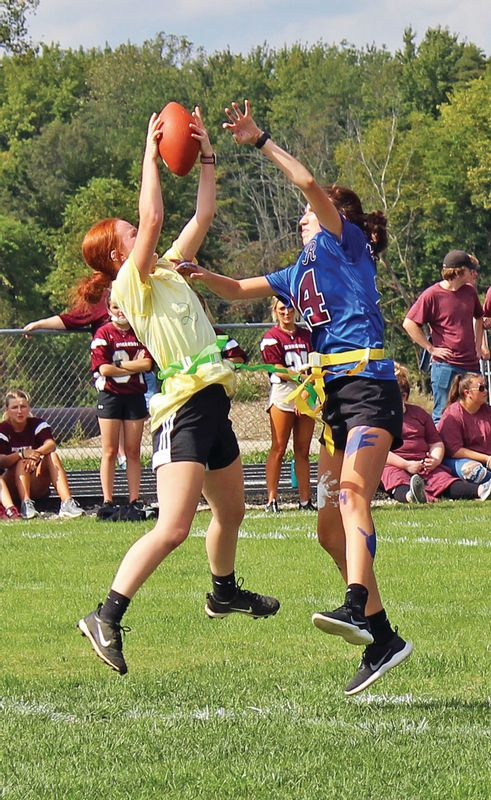 An RHS sophomore tries in vain to prevent a junior from catching a pass.