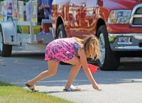 A young parade-goer scoops up candy during the 2019 Hutsonville River Fest Parade. Like many events, River Fest was canceled in 2020 because of the pandemic. Daily News photo