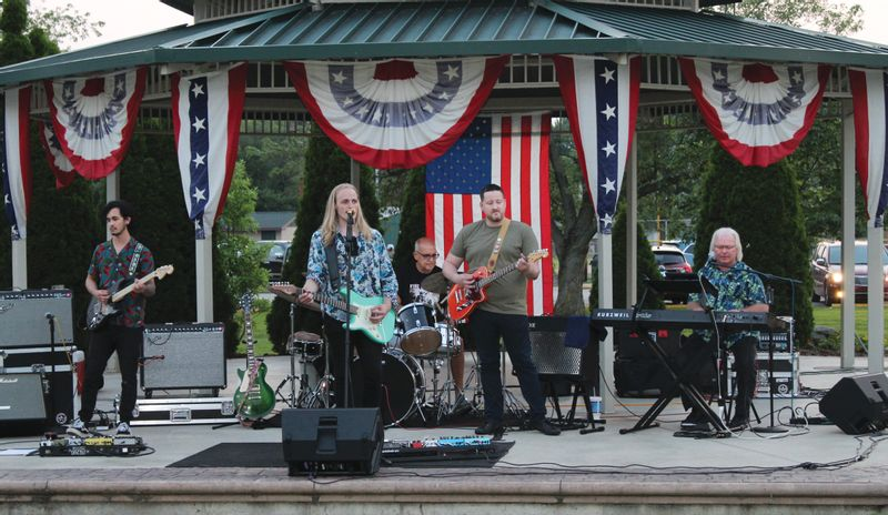 Damon Mitchell, and his band members, performed Sunday at the Robinson City Park. The performance was held before the fireworks show later that evening. Angela Downing | Daily News