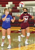 Robinson High School Maroon volleyball players watch as a ball heads their way during practice Tuesday. Randy Harrison | Daily News