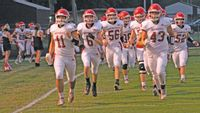 Lawrenceville High School's football team takes the field for the first time this season prior to their season opener at Marshall Friday night. The game was actually delayed for nearly 45 minutes due to inclement weather in the area, but the Indians were able to come away with a 45-35 victory and a 1-0 start to the season. Josh Brown | Daily Record