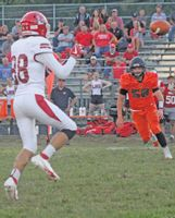 Lawrenceville's Bryant Jenkins (88) watches the ball on its way into his hands for a reception during Friday night's Little Illini Conference game at Olney. Jenkins caught four passes for 26 yards, but the Indians lost the game, 41-8. Contributed photo