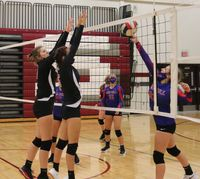 Lawrenceville's Lorien Vowells (left) and Kaya Tredway (right) attempt to block a hit attempt by Red Hill's Makaela Andrews (21) during their match at the Robinson Invitational Saturday. The Lady Indians won the match 25-14, 25-10 and went on to finish fifth with a 2-2 record, while Red Hill   and finished  . Josh Brown | Daily Record