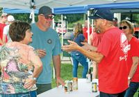Visitors and vendors enjoy the afternoon at the 2019 Fest of Ale. Daily News photo