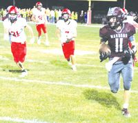 Robinson's Dylan York (11) has his eyes upfield as he heads up the sideline during a punt return Friday night against Marshall. York returned the punt untouched for a 76-yard touchdown to help the Maroons build a 28-0 halftime lead en route to a 46-6 win in the Little Illini Conference contest. Josh Brown   Daily News