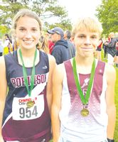Robinson's Katelyn Jones (left) and Austin Wesley (right) each received medals for finishing in the top-five of their respective races at the Mattoon Invitational Wednesday. Jones finished second out of 95 runners in the girls' race to help the Lady Maroons to a third-place finish, while Wesley came in fifth out 114 runners in the boys' race, helping the Maroons to a fifth-place team finish. Contributed photo