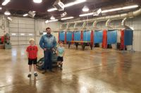 Title III Welding Specialist Maverick Fisher stands inside the newly renovated Welding Building at Olney Central College. Fisher and Welding Instructor Curtis Marshall made numerous improvements to the facility this summer. Pictured with Fisher are Marshall's sons, Jeremiah and Harrison, who pitched in and helped squeegee the floors. Contributed photo